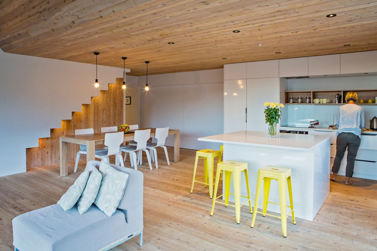 Inside, the decor is simple and palette of materials used is simple and dominated by wood