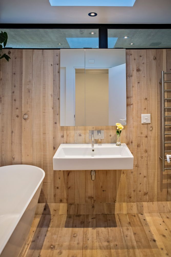 The en-suite bathroom is decorated in the same style as the bedroom