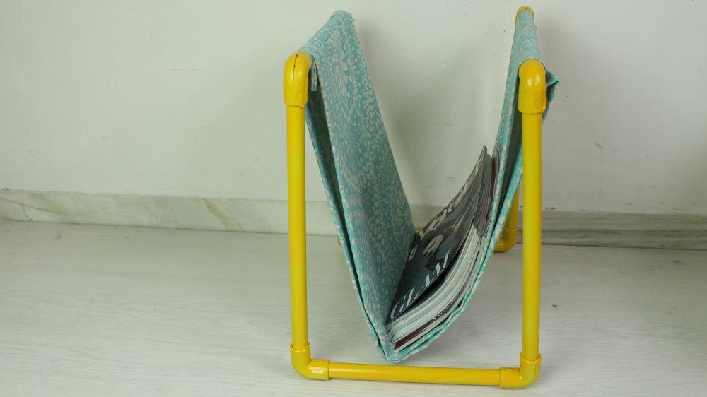 Yellow plastic pipes magazine holder