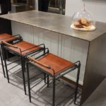 This kitchen island area from Ammuneal features four distinctly different materials.