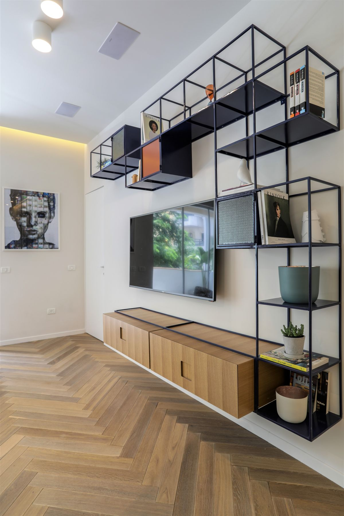 Asymmetrically placed shelving adds interest and draws attention to the window area.