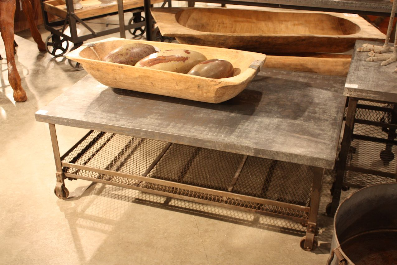 An industrial galvanized metal table can be a versatile addition to a room.