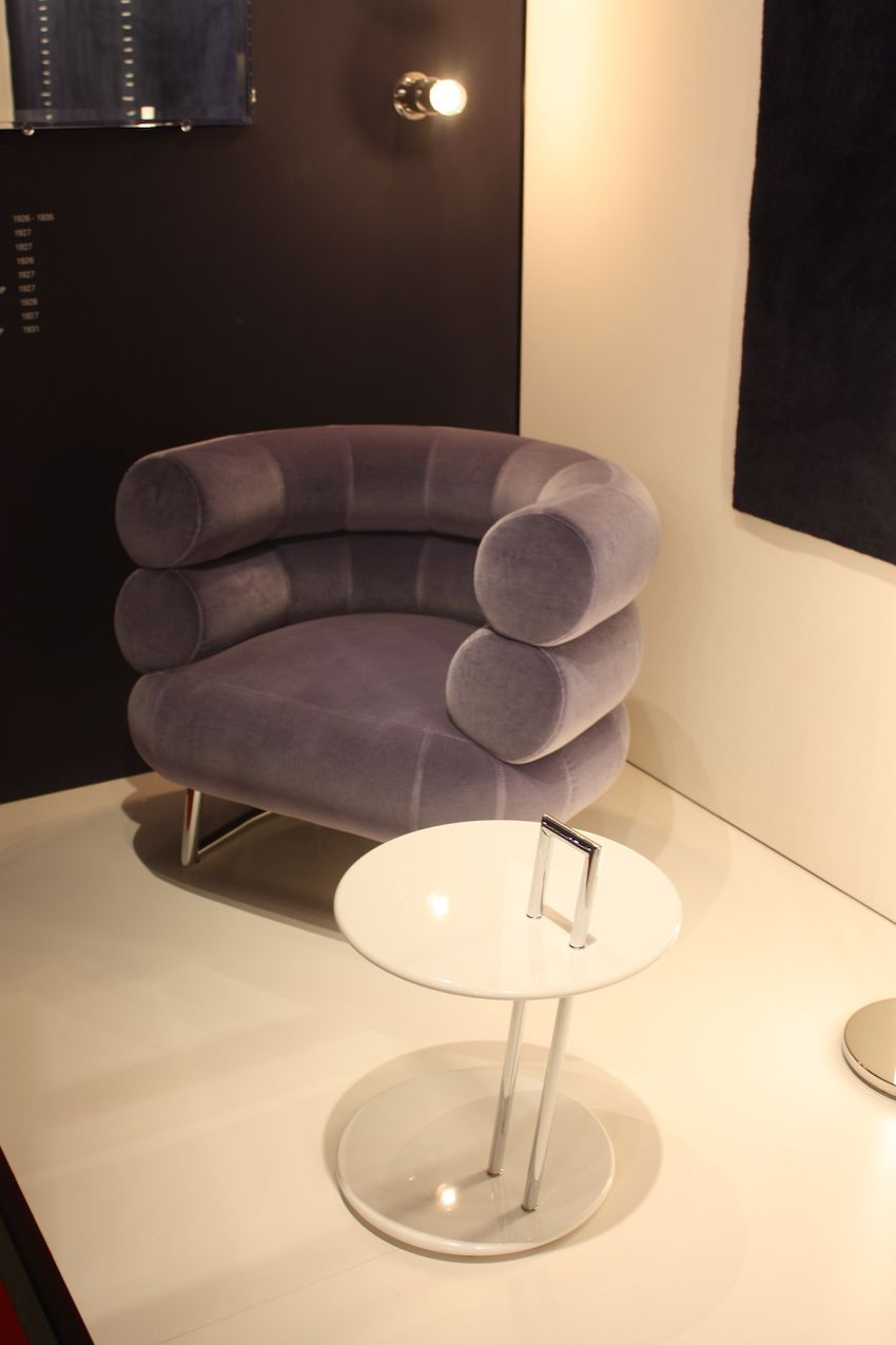 ClassiCon's velvet armchair has a deep, distinctive back and a subdued mauve color