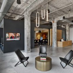 Modern furniture works well in a large, open industrial space.