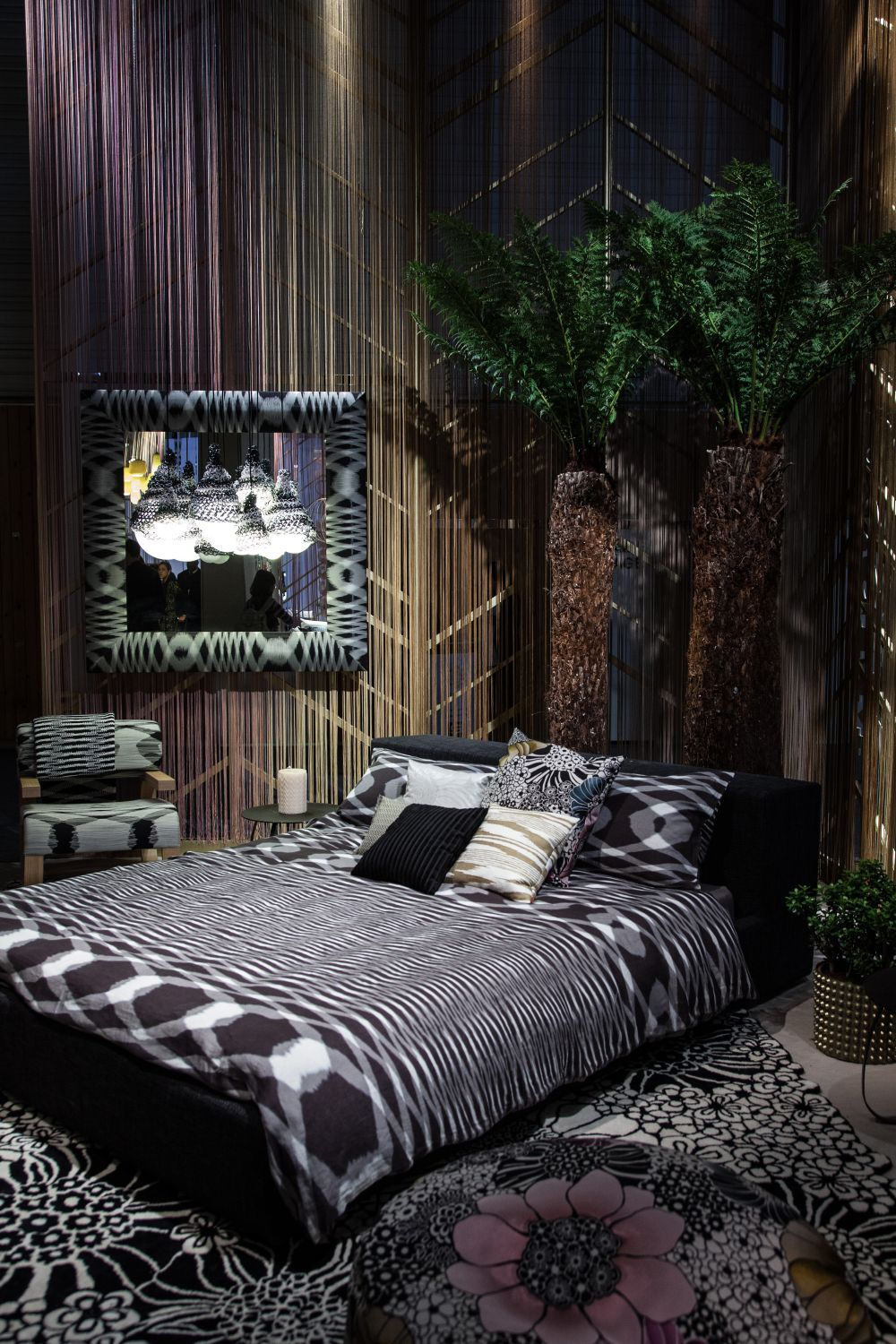 An eclectic bedroom decor can be characterized by an abundance of different prints and patterns