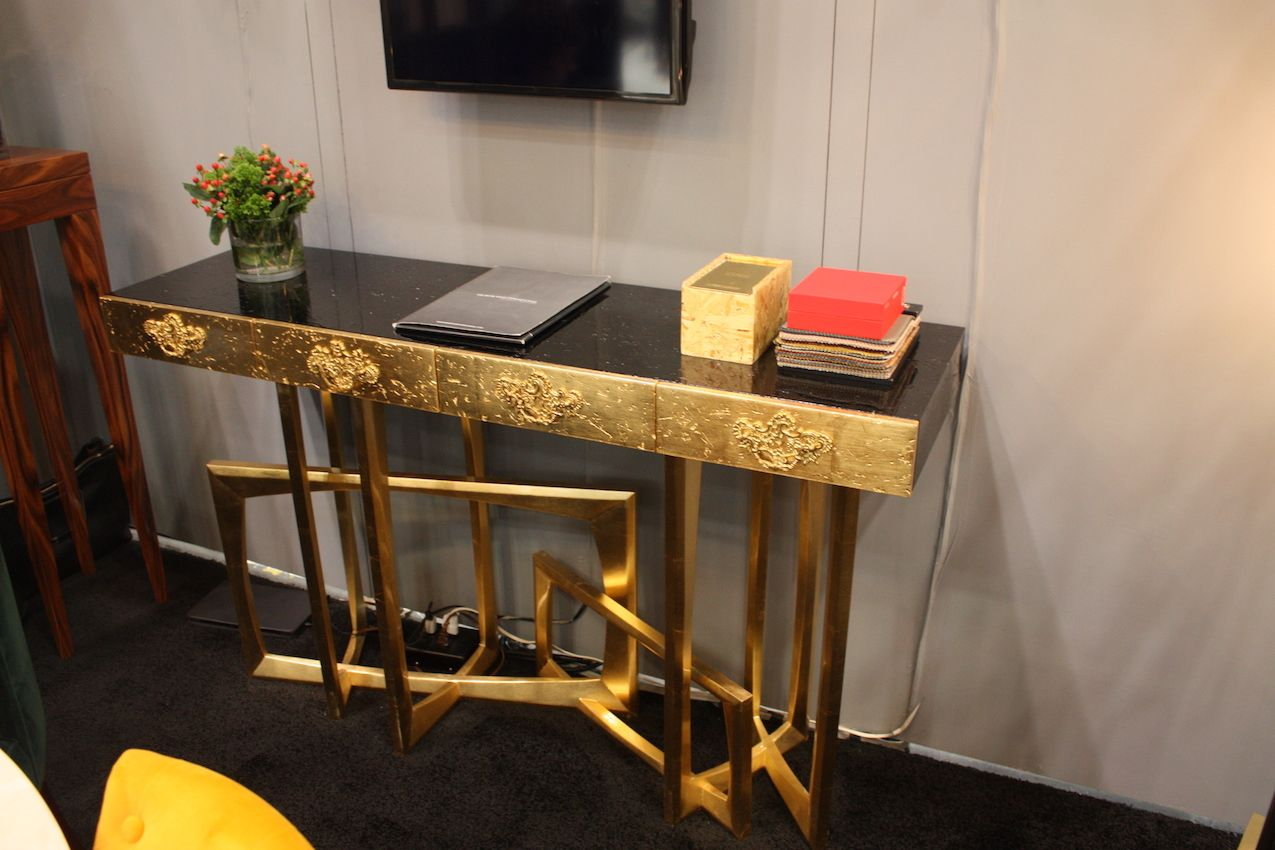 A fully gilded console table from Covet Lounge is a stately yet modern golden piece.