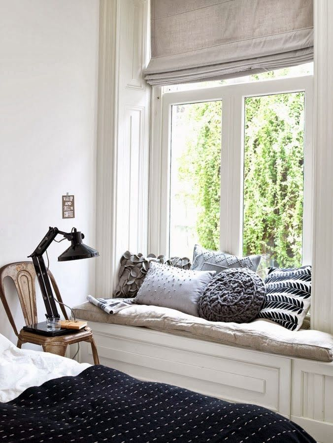 A modest window seat with gorgeous textured pillows is perfect.