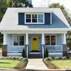 Craftsman cottage yellow door brick columns