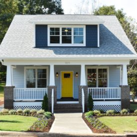 Craftsman cottage yellow door brick columns