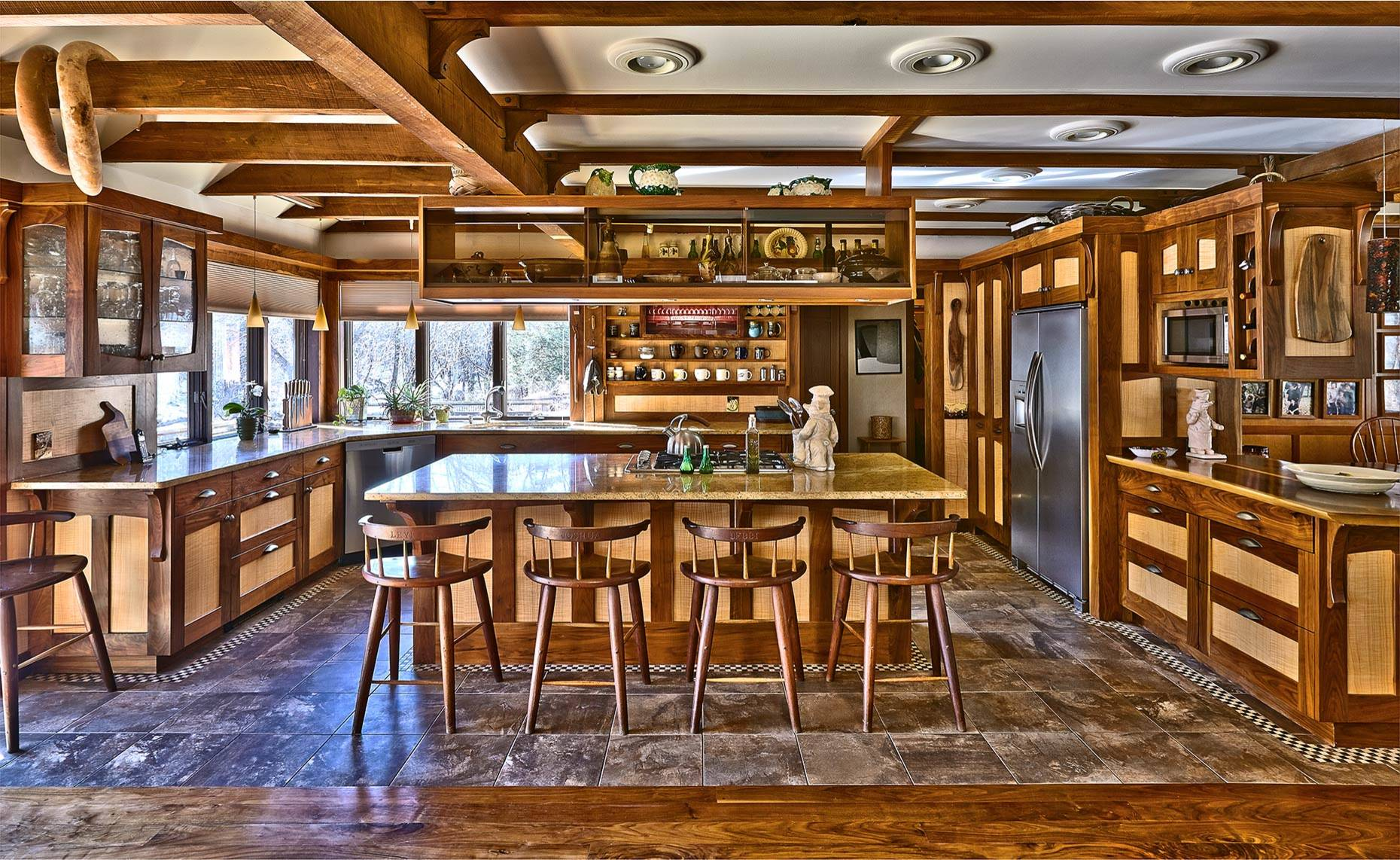 Everything you need to know about craftsman homes for Two tone wood cabinets