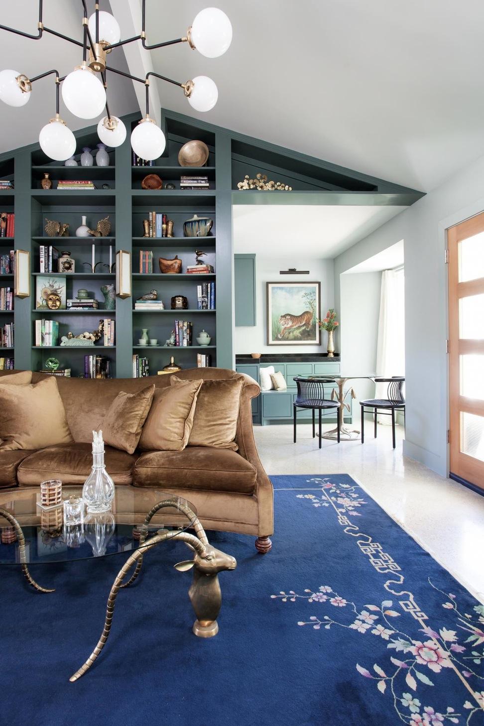 Eclectic living room teal bookshelves