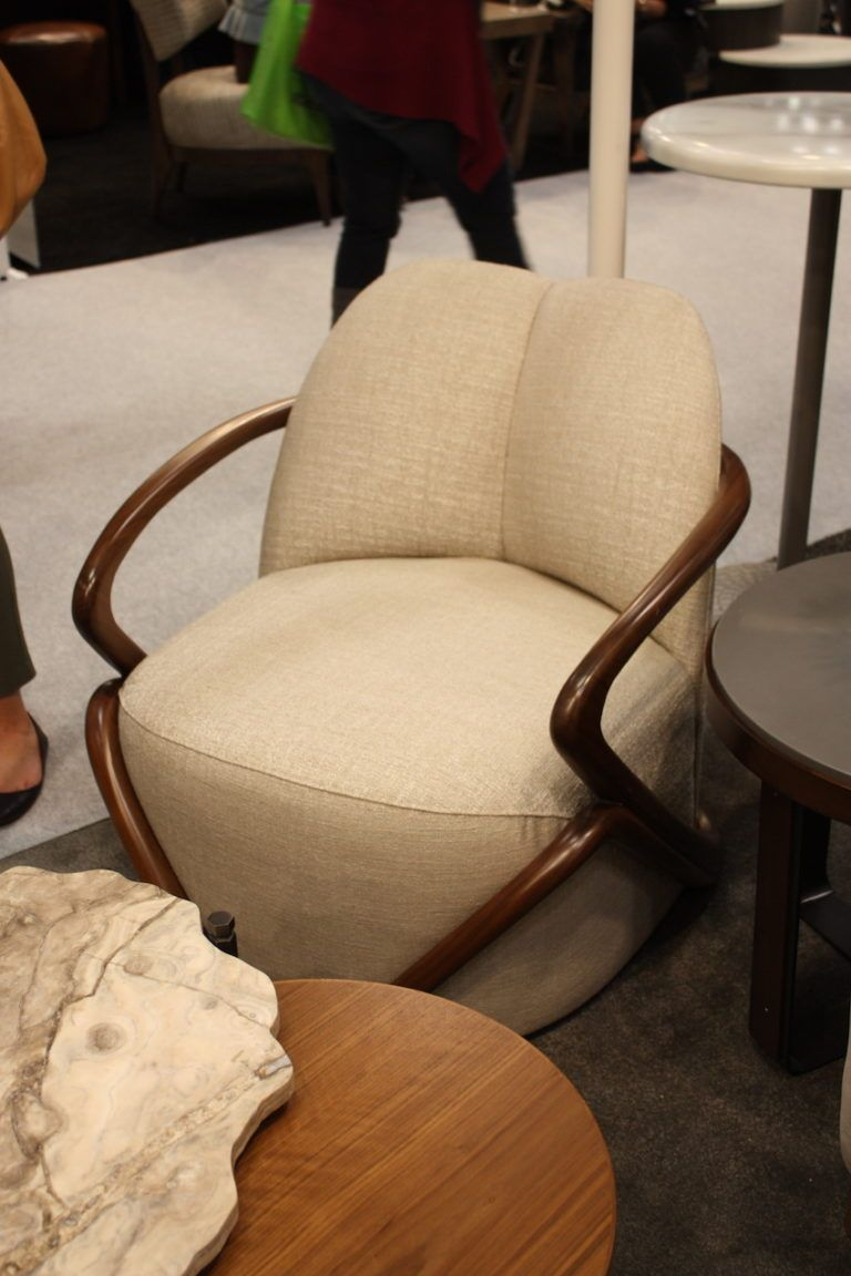 Neutral upholstery and a sleek wood frame are a versatile combination.