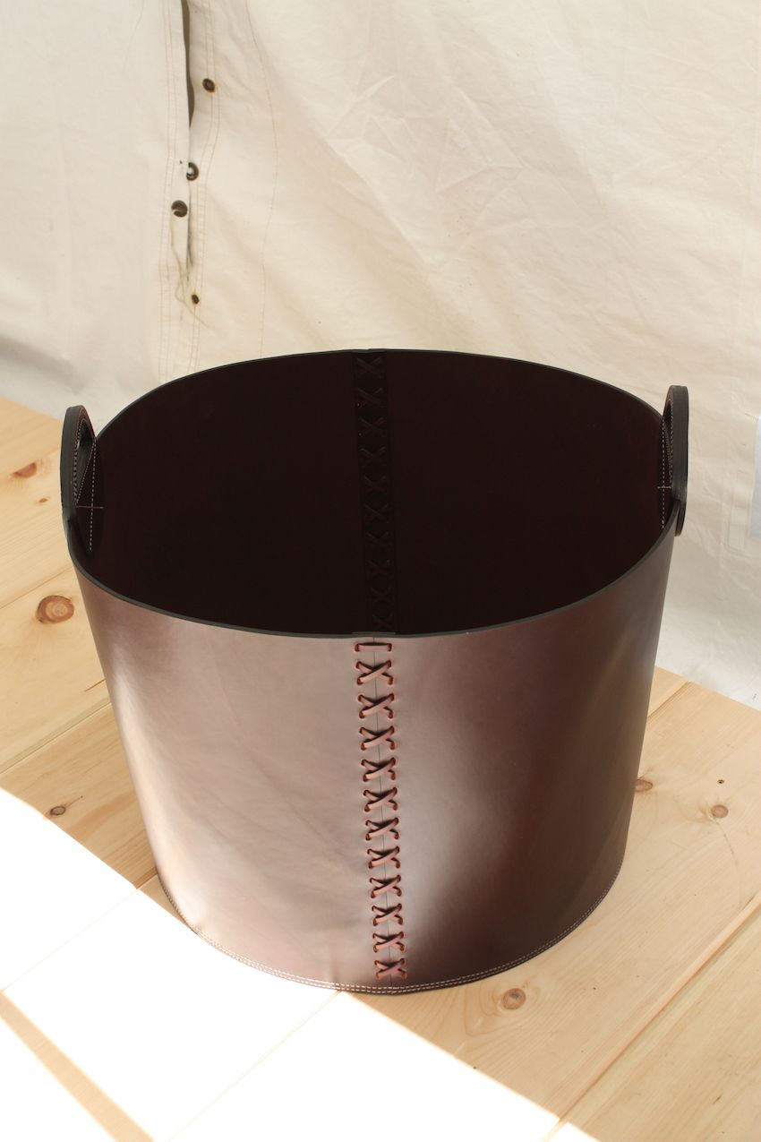 A hand stitched leather basket is a handsome and durable accessory.