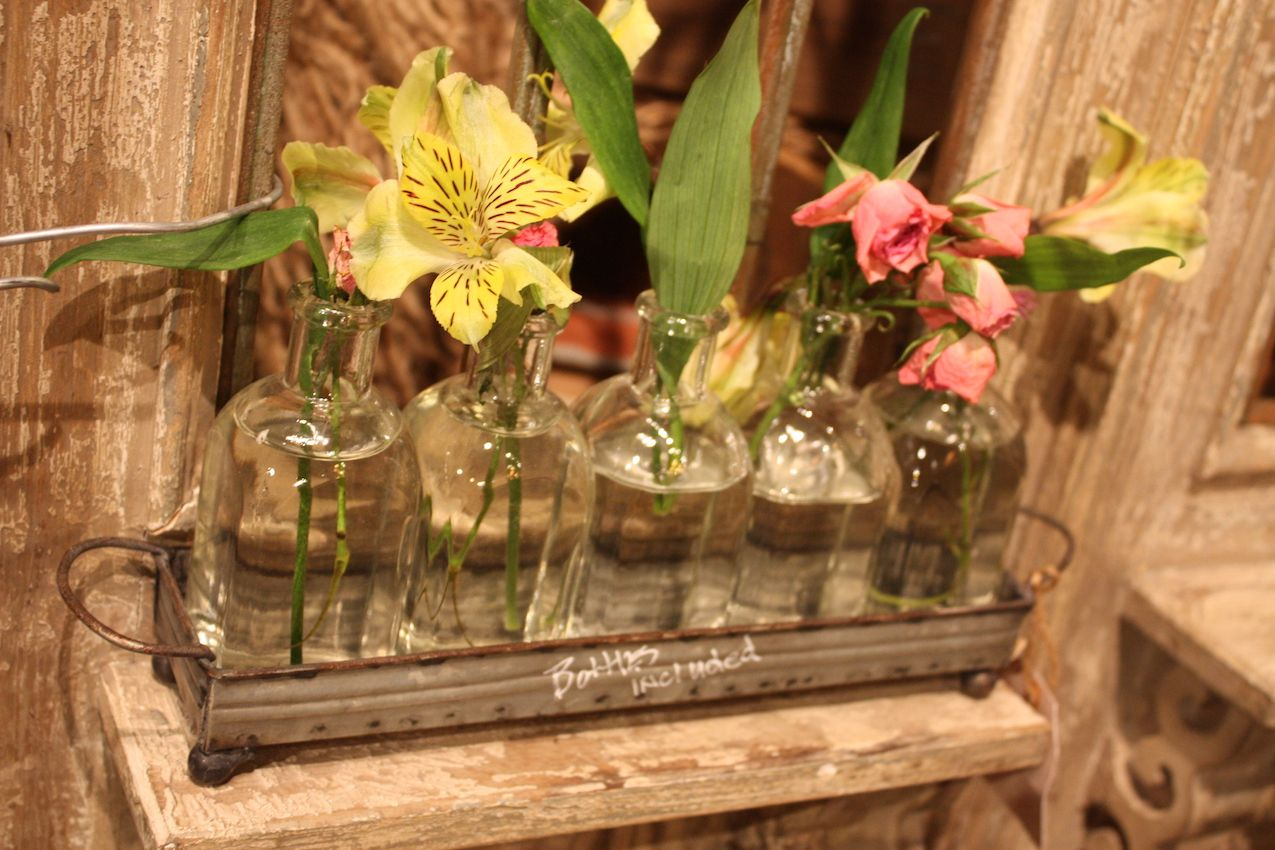 With flowers, the galvanized metal tray and small bottles are super cute.