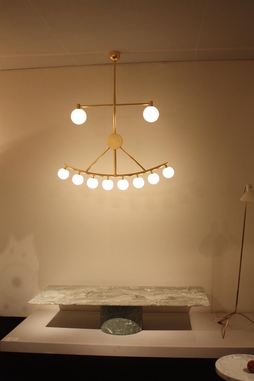 The light hangs above the ''M&C coffee table'' by Pierre Charpin.