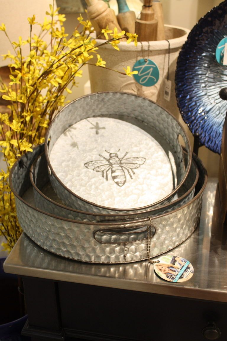 Galvanized metal trays from IMAX are part of the Trisha Yearwood Collection and feature a bee motif.