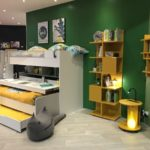 Kids room furniture in yellow with sliding beds and tree books