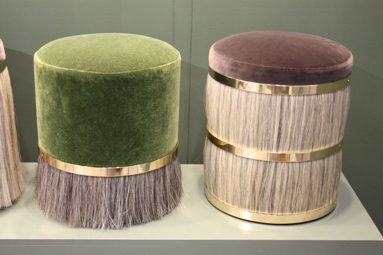 Luxe stools from Konekt feature mix velvet, gold accents and hair fringe.