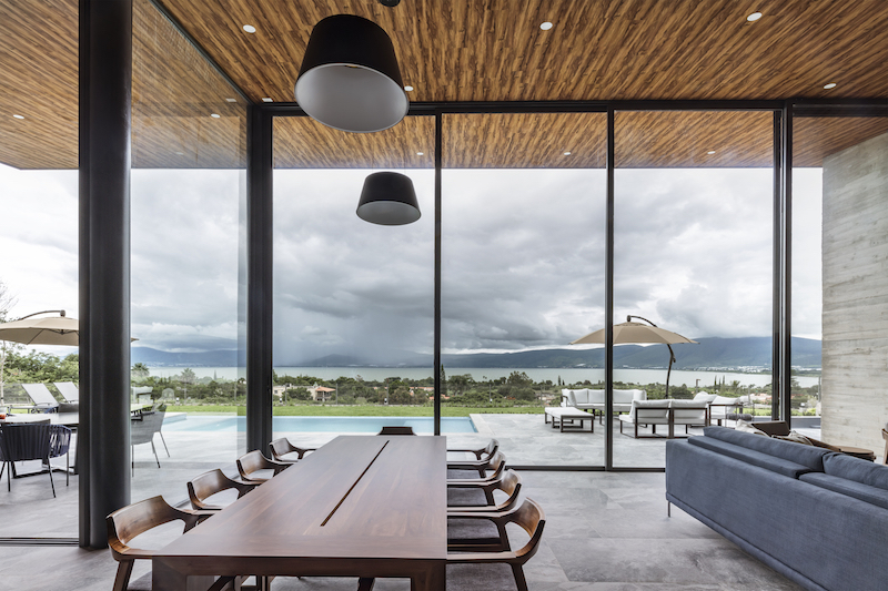 The views from the living and dining areas frame the lake and the mountains, providing a dreamy look