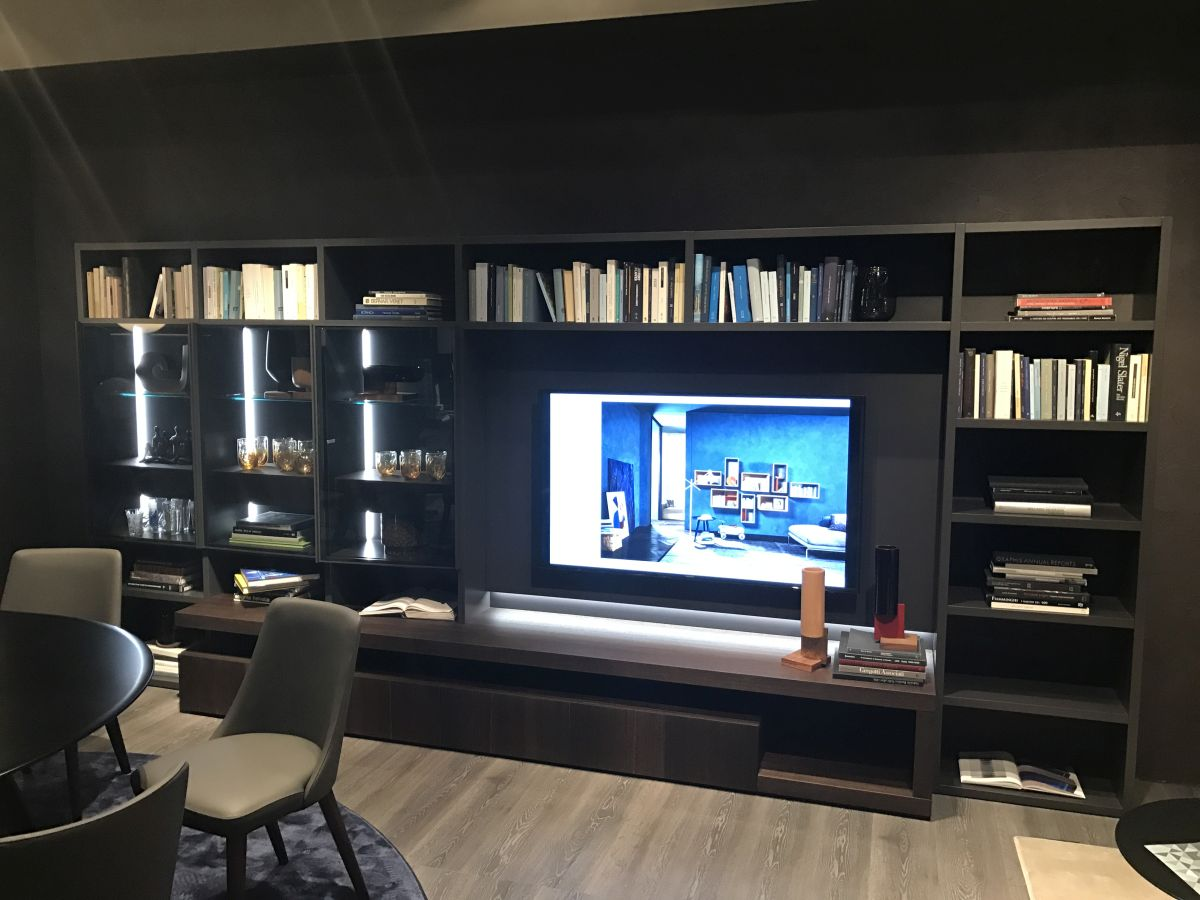 In the living room, you can balance out books with electronics by displaying them in the same unit