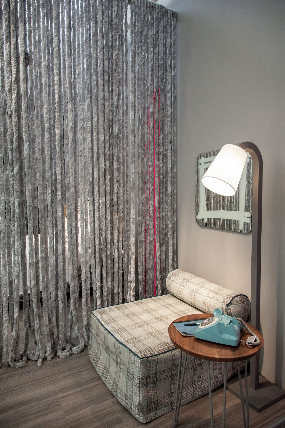 You can separate your reading nook from the rest of the room using curtains or a divider