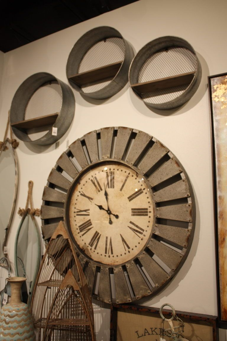 Grouping metal items that have a patina emphasizes the rustic or industrial tone of a space.