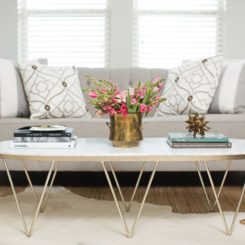 Modern coffee table with hairpinlegs and decorated with rule of three