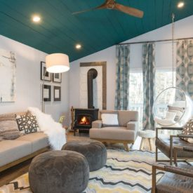Modern living room with teal shiplap ceiling