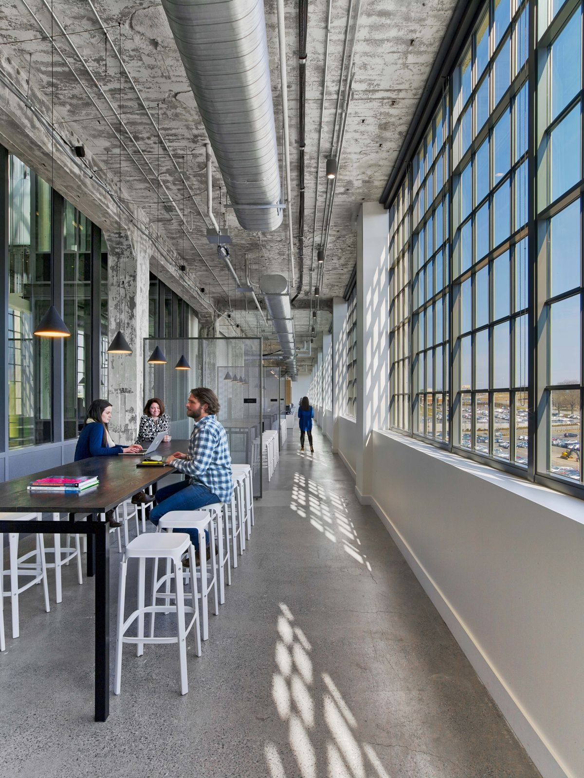 The area is good for employees to spread out and work, alone or in collaboration.