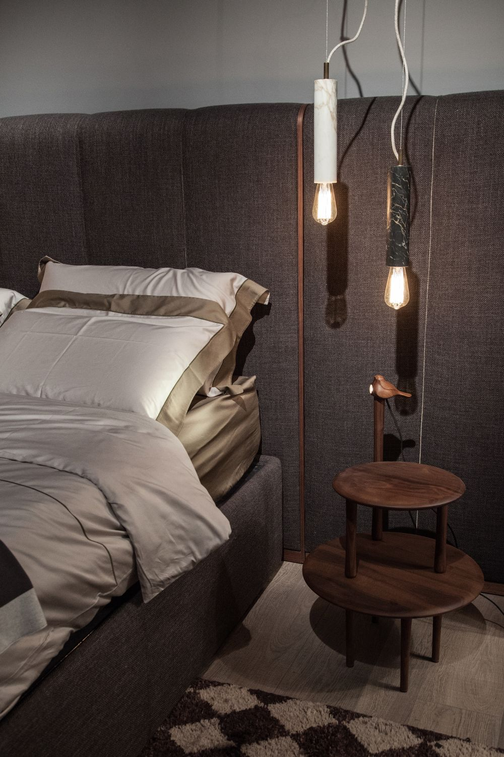 Instead of the usual table lamp, perhaps a hanging pendant would be a more stylish and modern option