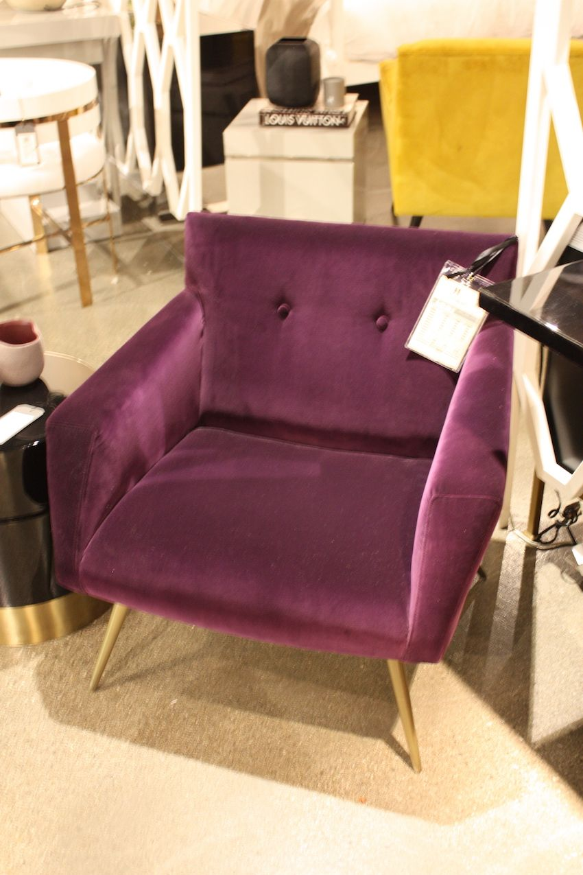 Pick a rich color like this plum velvet armchair from Resource Decor.