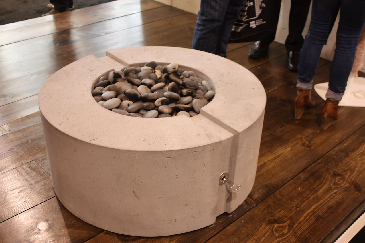 Outdoor fire pits are not losing popularity either and this concrete model from DEK is super stylish.