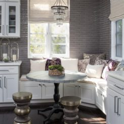 Small chandelier over the breakfast nook bench
