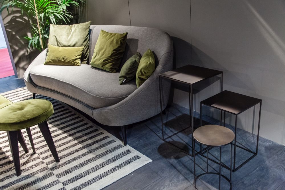 A small sofa or daybed can be a good replacement for the chair