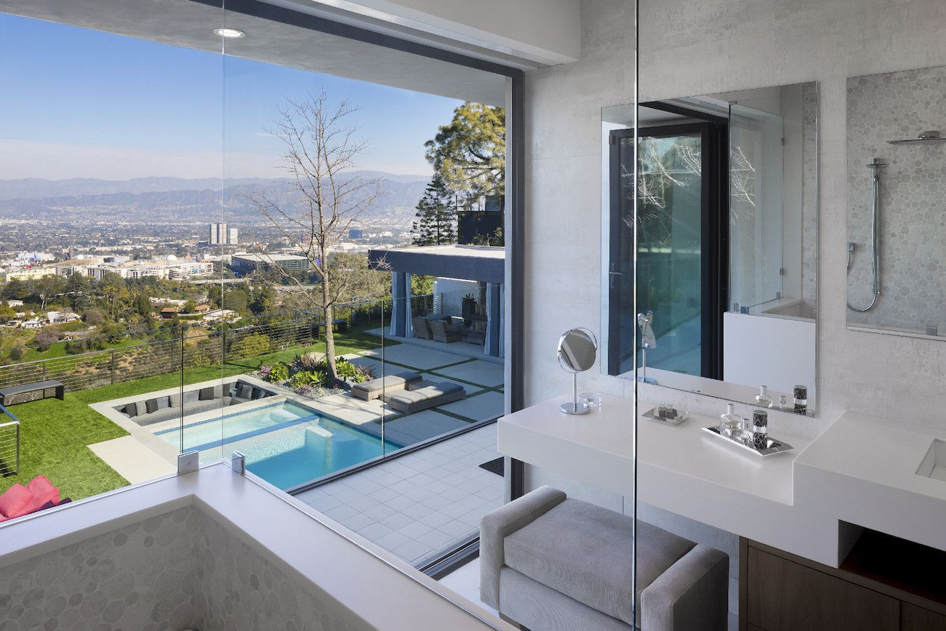 Privacy and a great view are two important elements of this glass walled bathroom.