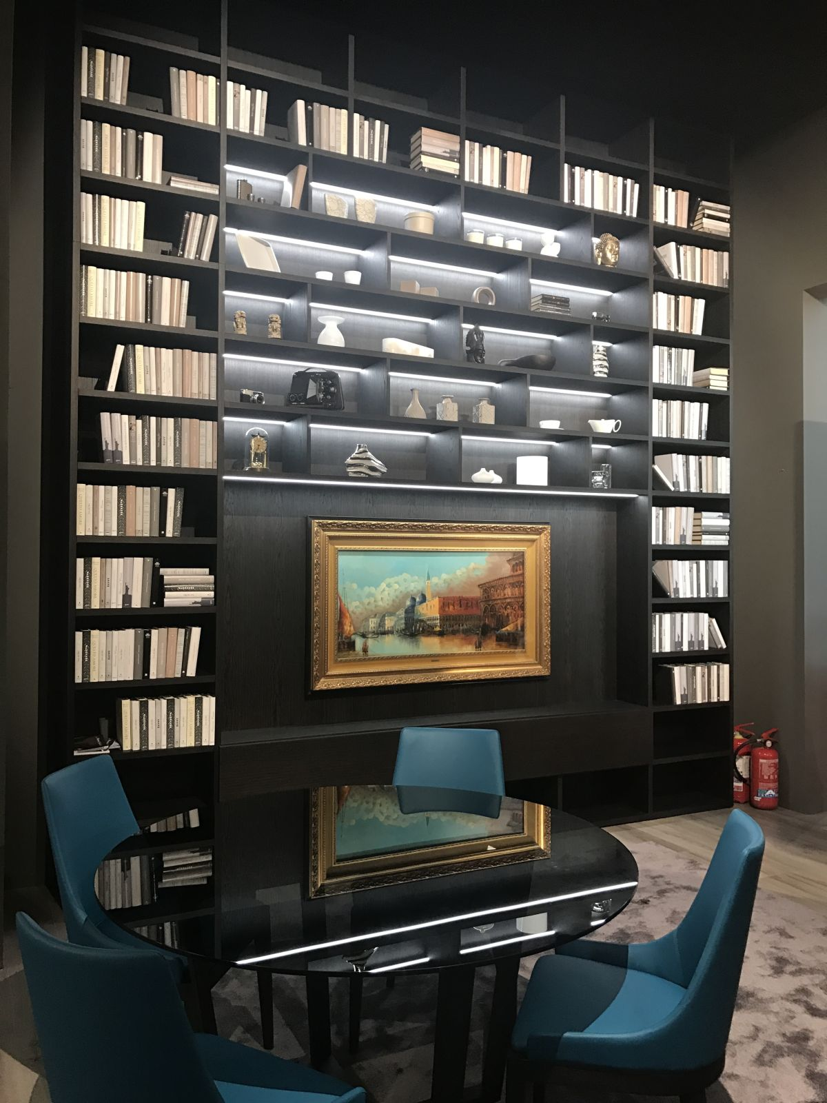 For extensive book collections, it's best to opt for a large bookcase that can keep them all in one place