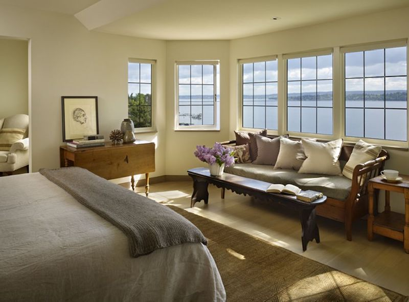 The windows in the master bedroom frame the lake views and bring lots of natural light inside
