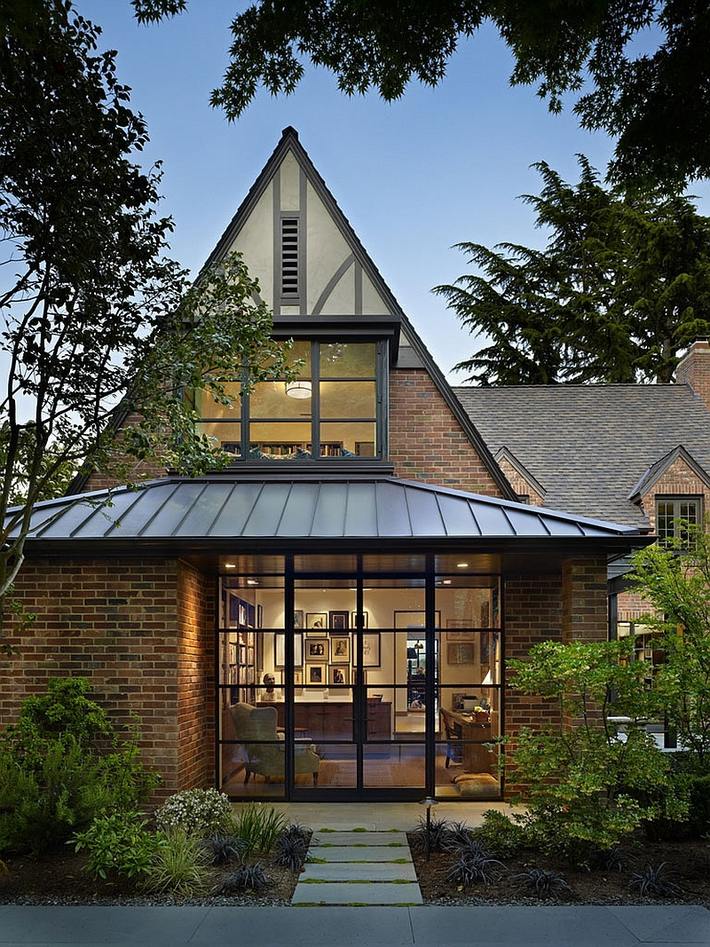The house is designed in the Tudor style, featuring a series of specific elements to suggest that