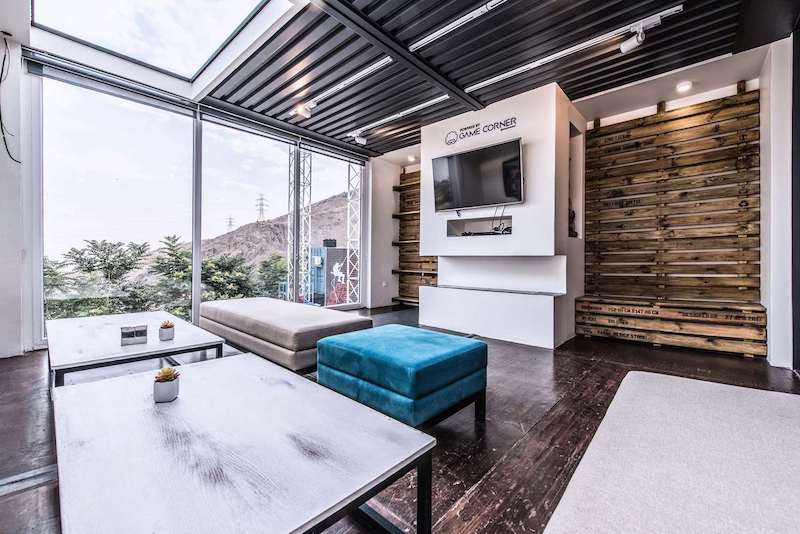 Another zone is a game area with a cozy lounge space that features reclaimed wood on the walls