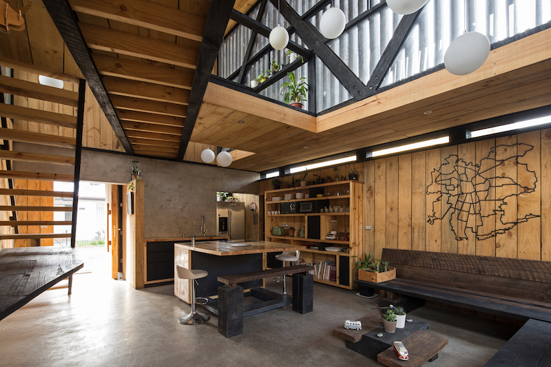 The interior of the house has been completely reorganized and now features a double-height space at the center