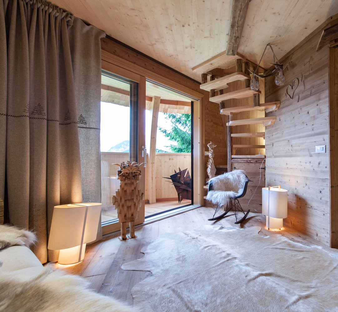 A set of stairs connects the living area to the bedroom, carefully wrapping around the walls