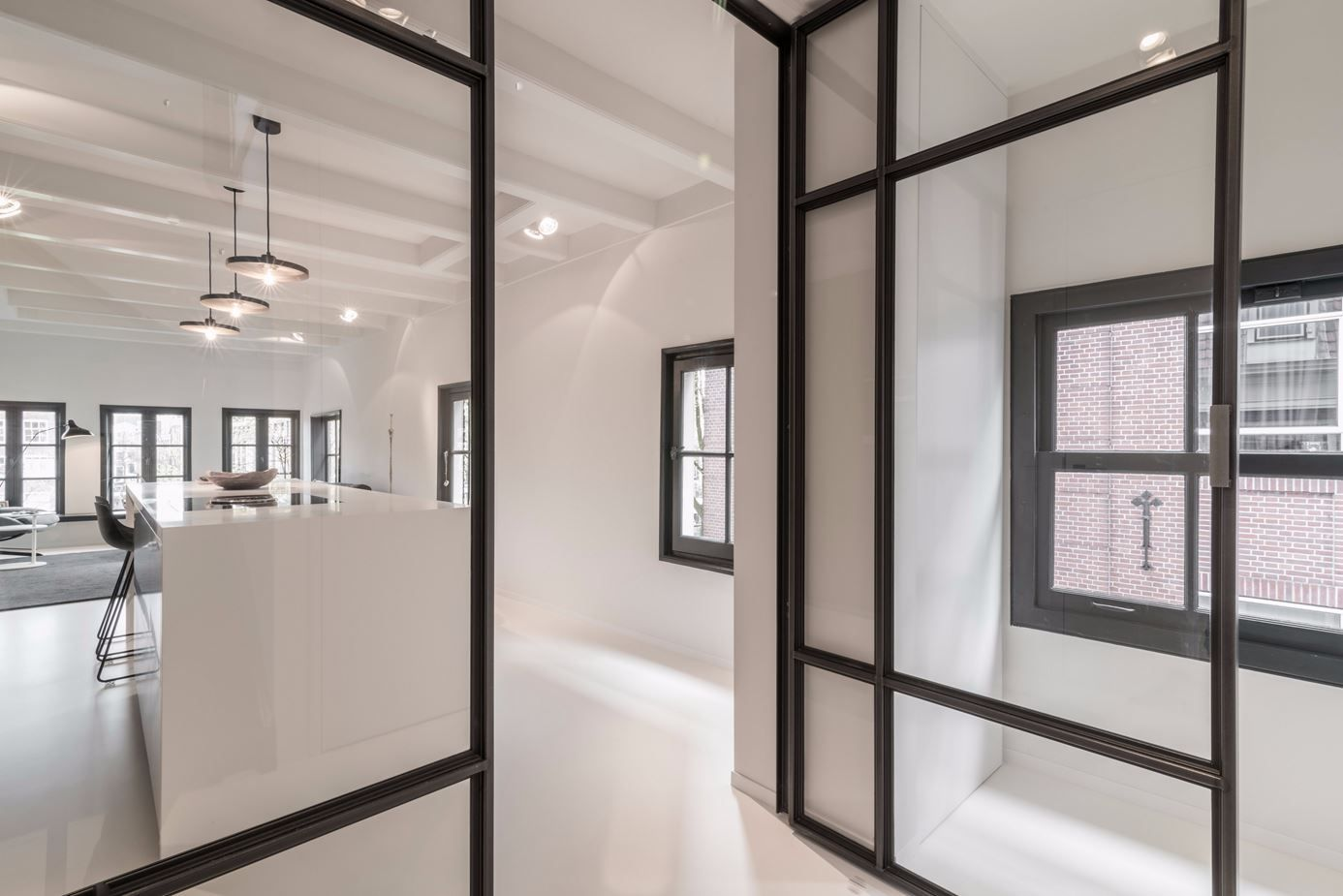 The glass doors allow extra light into the hall and stairwell.