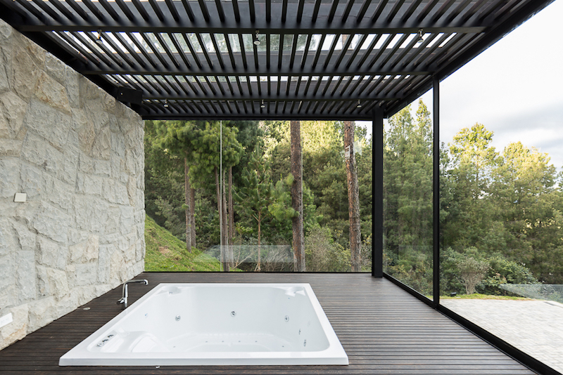 There's also a wooden deck section with a built-in tub which makes the most of the views