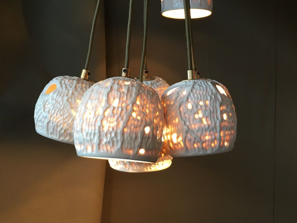 The porcelain lights are available as single pendants as well.
