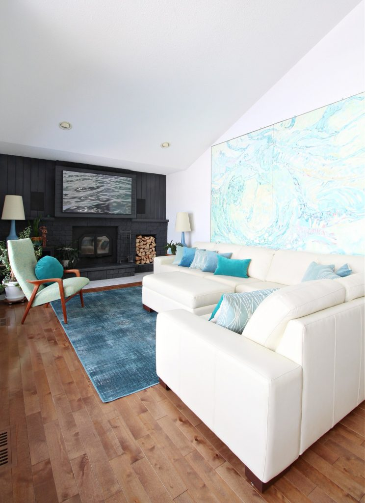 A light and airy blue-green living room