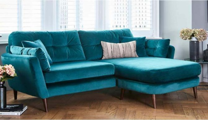 A centerpiece of a teal sofa