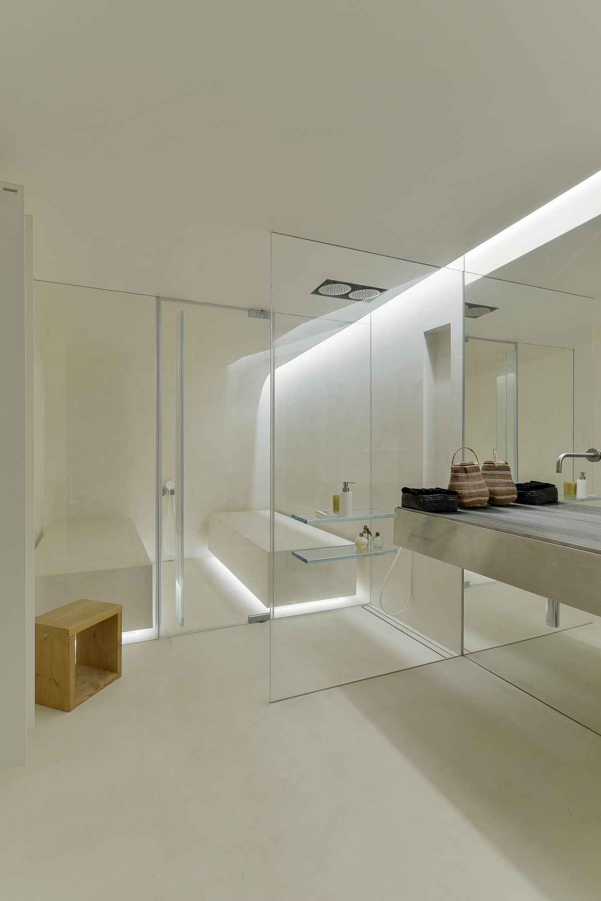 A second bathroom features glass, a full tub and spacious vanity area.