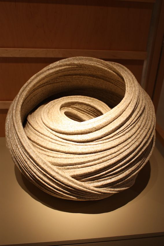 The stoneware has a sand glaze that further ties the piece to the sea.