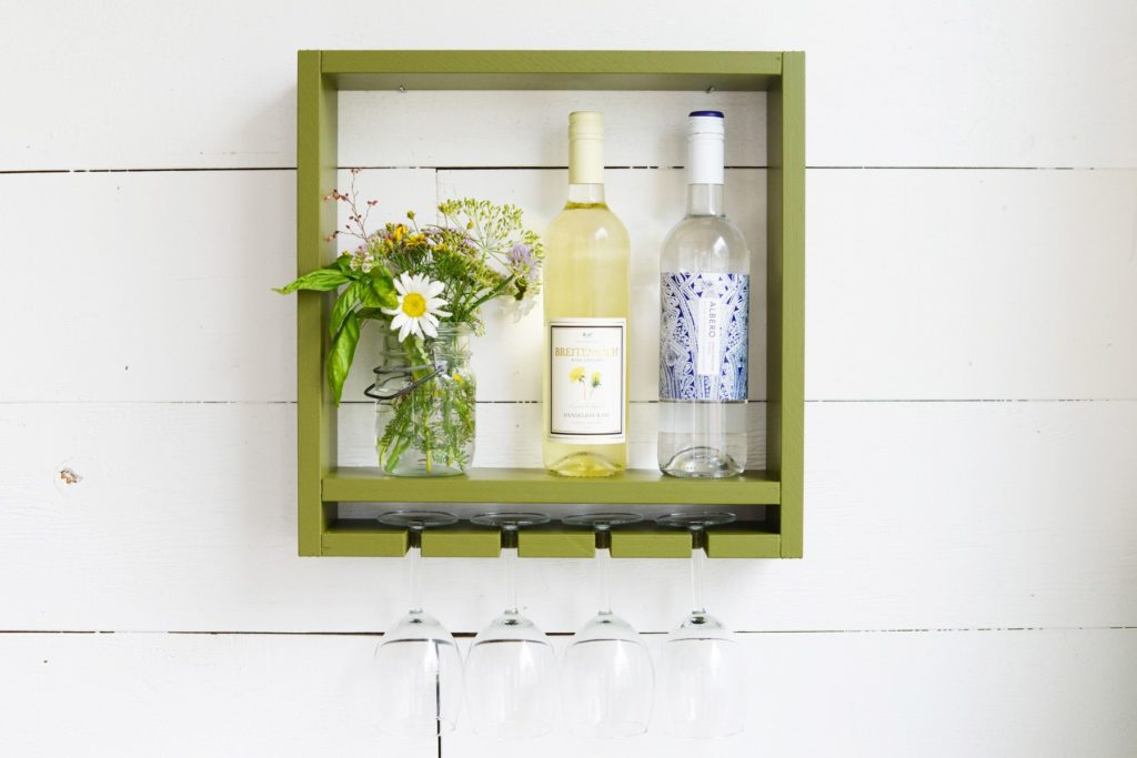 Small, wall-mounted wine rack made of wood