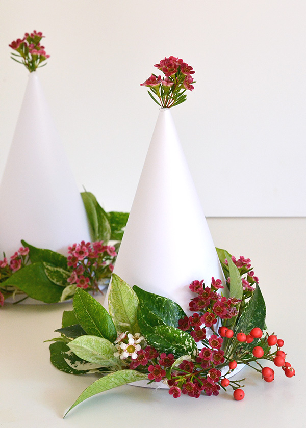 A Bunch Of Christmas Flower Arrangements Infused With Holiday Charm